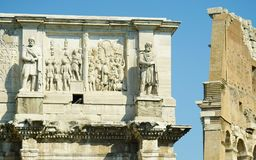 Bas-reliefs and statues of Constantine arch. Bas-reliefs and sculptures on the triumphal arch of the Constantine emperor in Rome Royalty Free Stock Photos