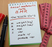 Basal metabolic rate, BMR. Measuring tape, a marker and a notepad with a  calculation of bmr. Basal metabolic rate Royalty Free Stock Photos
