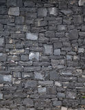 Basalt blocks wall. Staggered wall with rough basalt blocks stock images