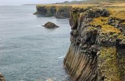 Basalt cliffs at Arnarstapi Stock Photo