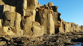 Basalt column rock formation. This clips is of a Basalt column rock formation from an Extinct Volcano. Abstrack rock background stock video footage
