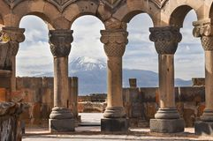 Ruins of the Temple of Zvartnots and the Mount Ararat in the background, in Yerevan, Armenia. Basalt columns in the ruins of the Zvartnots Temple with the Mount Royalty Free Stock Photography