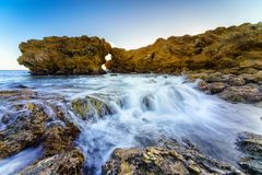 Basalt formations at the coastline. In USA Stock Images