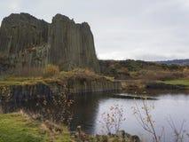 Basalt pillars lava vulcanic rock formation organ shape with lak. E panska skala in kamenicky senov prachen czech republic Stock Image