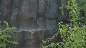 Basalt pillars in the rain. Basalt columns in the pouring rain in nature stock video