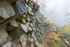 Basalt prisms in the forrest. Basalt prisms in a foggy autumn forrest royalty free stock photography