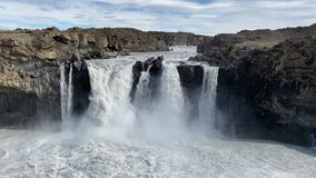 The basalt rock formation surrounding Aldeyjarfoss area in Northeast Iceland you find this powerful river and waterfall.