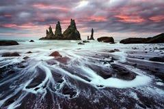 Basalt rock formations `Troll toes`. Basalt rock formations Troll toes on black beach. Reynisdrangar, Vik, Iceland Royalty Free Stock Photography