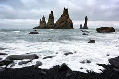 Basalt rock formations `Troll toes`. Basalt rock formations Troll toes on black beach. Reynisdrangar, Vik, Iceland Stock Photography