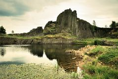 Basalt rock and pond Stock Photo