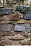 Basalt rock wall background - stone wall surface pattern Royalty Free Stock Image