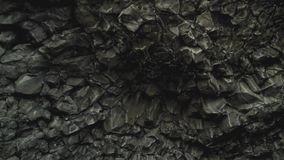 Basalt Rocks at the Black Beach in Vik. Close up detailed shot of famous basalt rocks at the Black Beach in Vik, Iceland. Volcanic geological formation. Travel stock video footage