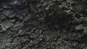 Basalt Rocks at the Black Beach in Vik. Close up detailed shot of famous basalt rocks at the Black Beach in Vik, Iceland. Volcanic geological formation. Travel stock footage