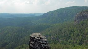 Basalt rocks in national park reserve Bohemian Switzerland in Czech in sunny weather. Amazing nature stock footage