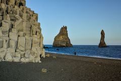 Basalt stone columns on Reynisfjara black beach near Vik town. Iceland on sunny summer day royalty free stock photos
