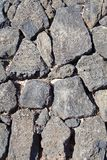Basalt (volcanic rock) wall made Stock Photos