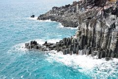 Basaltic columnar joint coast Royalty Free Stock Images