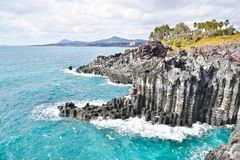 Basaltic columnar joint coast. In JungMun in Jeju Island royalty free stock image