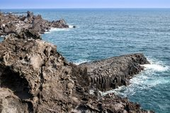 Basaltic columnar joint coast in JungMun Royalty Free Stock Photo