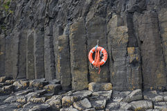 Basaltic columns, Staffa. Close view of the basalt columns of the Isle of Staffa, Scotland. Life-buoy is hanging from one of the columns Stock Photography