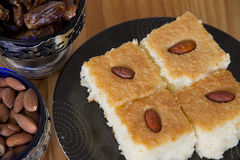 Basbousa with Almonds and Dates Royalty Free Stock Photos