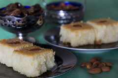 Basbousa with Almonds and Dates on a Table Royalty Free Stock Photo