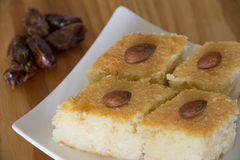 Basbousa with Dates on a Table Stock Photos