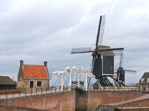Bascule bridge and windmill in Heusden. Royalty Free Stock Photo