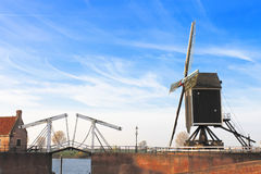 Bascule bridge and  windmill at sunset. Stock Photography