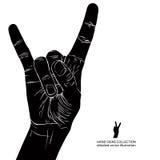 Basculez en main le signe, petit pain de la roche n, hard rock, métal lourd, la musique, d Photographie stock libre de droits
