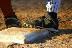 On Base. Close up of feet from two baseball players on base Royalty Free Stock Images