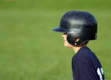 On Base. Little League baseball player on first, waiting to run Royalty Free Stock Photos
