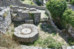 Base of ancient oil press. Stock Photo