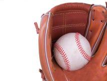 Base-ball étant attrapé dans un gant de base-ball photographie stock