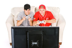 Base-ball : Amis jouant des jeux vidéo Photographie stock libre de droits