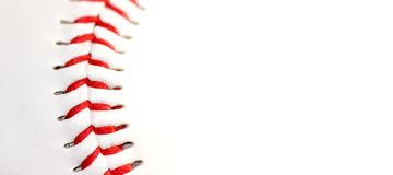 Base ball close up. White leather base ball with red stitching Stock Image