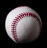 Base-ball sur le fond noir Images libres de droits