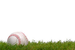 Base-ball dans l'herbe Photos libres de droits
