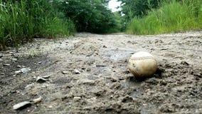 Base-ball dans le sable Images libres de droits