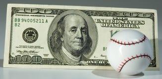 Base-ball et $100.00 Photos stock