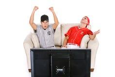Base-ball : Homme encourageant avec agitation pour l'équipe Images stock