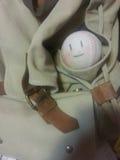 Base-ball mignon dans le sac à dos Photographie stock libre de droits