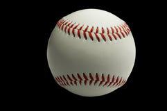 Base-ball sur le noir Photos libres de droits