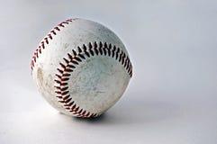 Base-ball usé et superficiel par les agents Photographie stock libre de droits