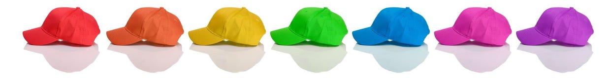 Base-ball : Vue de côté des casquettes de baseball colorées Images stock