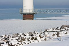 Base of a big offshore windturbine in a frozen sea Stock Image