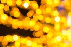 Base borrada redonda do ouro amarelo da festão das lanternas dos pontos estofamento baixo do fundo colorido de muitos círculos imagem de stock royalty free