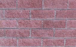 Base brick wall terracotta row of rectangular stones with gray lines background urban part of the fort stock photos
