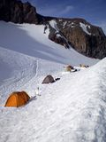 Base Camp. Mountaineers tents lined up at the base camp for Mount Rainier, Camp Muir Royalty Free Stock Images