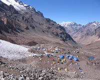 Base Camp View Aconcagua, Argentina. Spectacular view overlooking the brightly colored tents of Aconcagua base camp, Plaza de Mulas, in Argentina in South Royalty Free Stock Photos